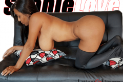ShanieLove naked on a couch