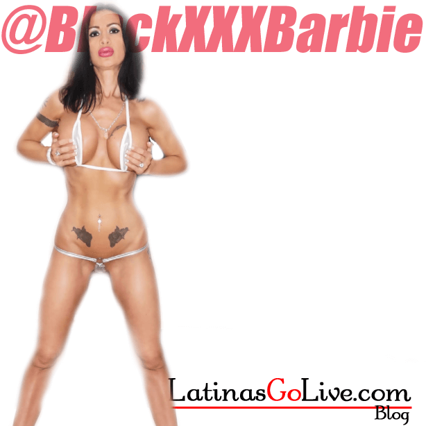BlackxxxBarbie playing with her huge fake tits in a white micro bikini