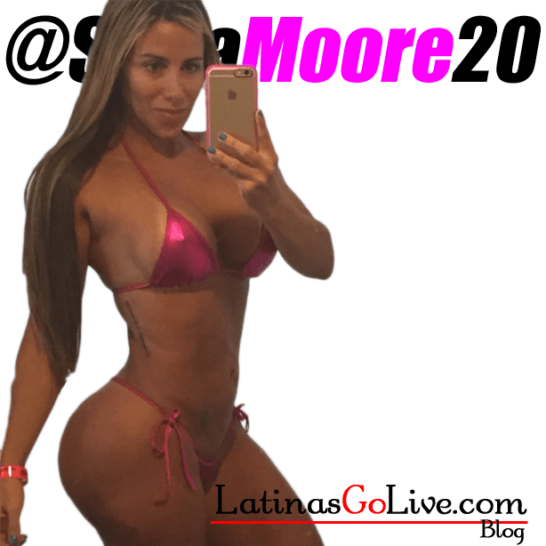 latin cam girl Sofi_Moore taking a sexy selfie with iphone 6 while wearing a pink bikini